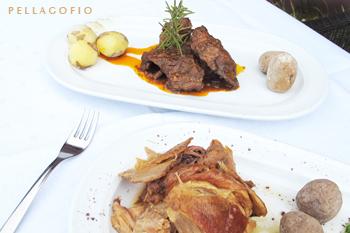 Cochino negro asado en horno de leña y conejo en salmorejo, dos de las especialidades del restaurante de la bodega.| FOTO Y. MILLARES